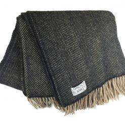 belgravia charcoal grey & beige herringbone blanket fanned out from above